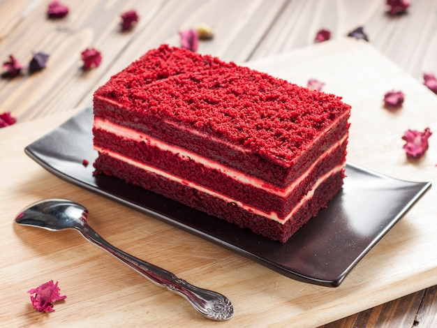 Red velvet cake on wooden board Premium Photo