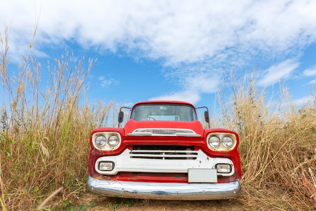 Red vintage car with blue sky Free Photo