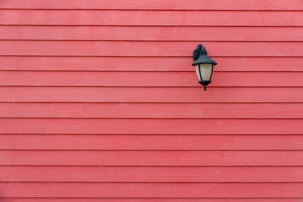 Red wall lamp in a park Premium Photo