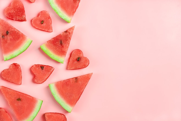 Red watermelon pattern. creative layout made in shape of heart of watermelon on pink. Premium Photo