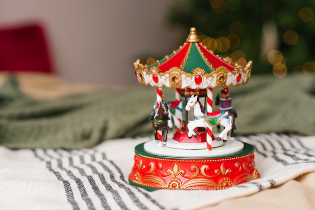 Red and white carousel toy on christmas lights Premium Photo