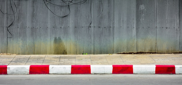 Red and white line at concrete road in the urban. Premium Photo