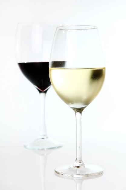 Red and white wine in glasses Free Photo