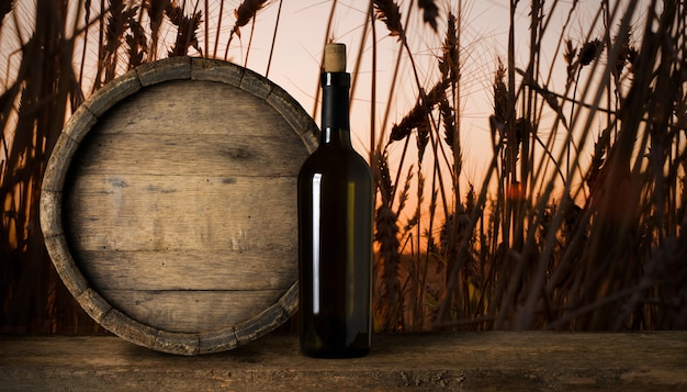 Red wine bottle on a wheat background Premium Photo