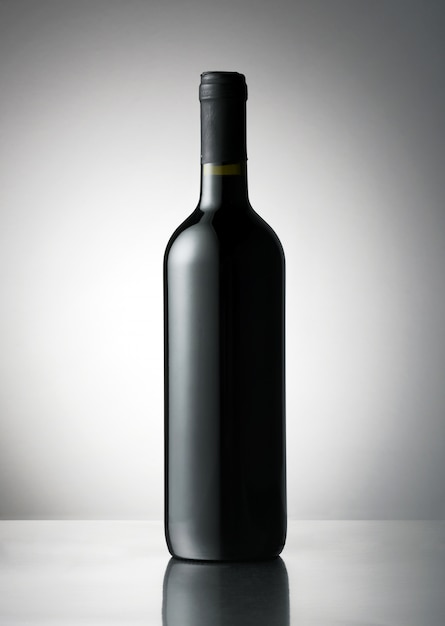 Red wine bottle with a blank label for branding Premium Photo