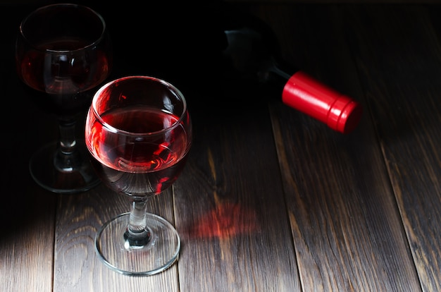 Red wine in glass and bottle of wine Premium Photo