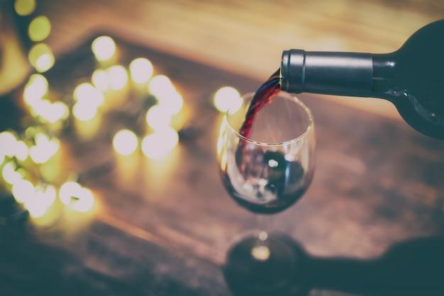 Red wine pouring into wine glass. Premium Photo