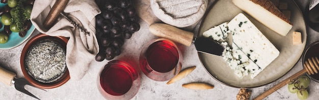 Red wine with charcuterie assortment on rustic concrete backgrou Premium Photo