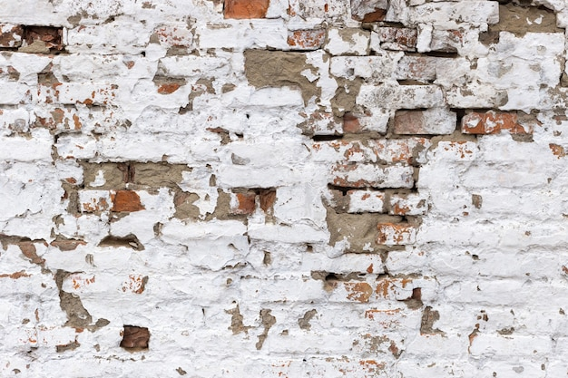 화이트 레트로 그런 지 Brickwall 배경으로 레드입니다. Stonewall 바탕 화면. 벗 겨 석고와 빈티지 벽입니다. 프리미엄 사진