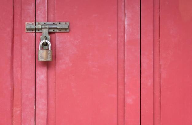 Red wood gate with lock, locked wooden doors Premium Photo