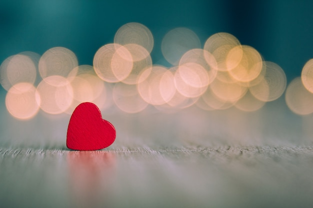 Red wooden hearts with an unfocused background Premium Photo