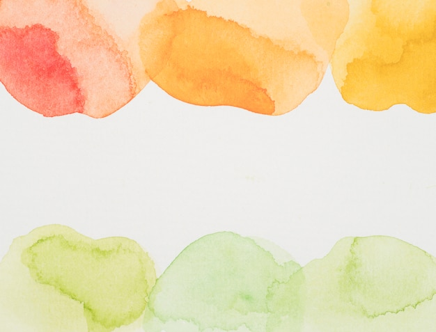 Red, yellow and green paints on white paper Free Photo