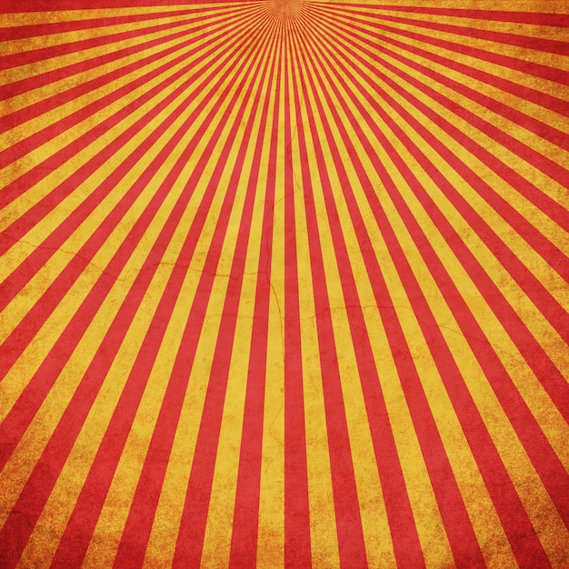 Red and yellow grunge sunburst vintage background with space Premium Photo