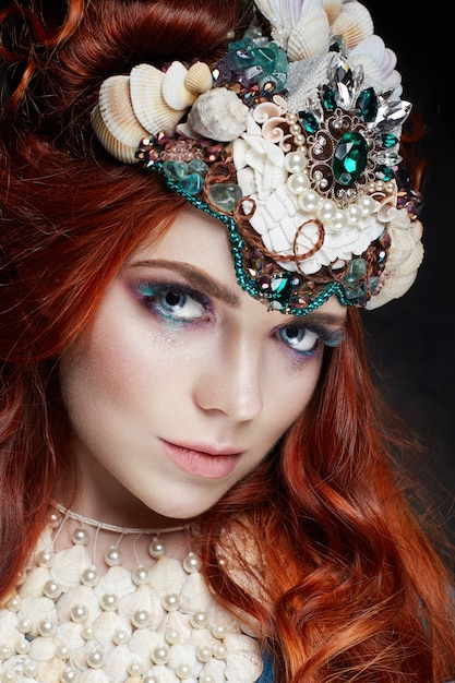 Redhead girl with bright makeup and big lashes Premium Photo