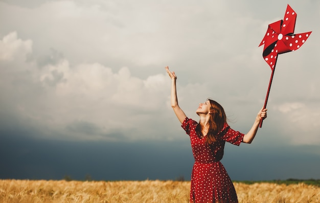 Redhead girl with toy wind turbine Premium Photo