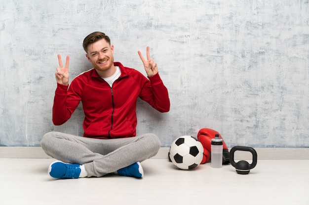 Redhead sport man showing victory sign with both hands Premium Photo