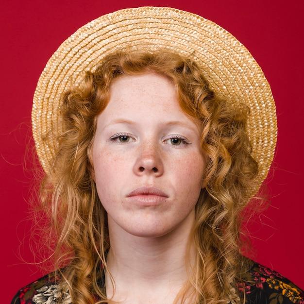 Redhead woman looking at camera Free Photo
