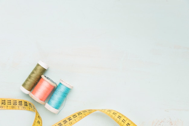 Reels of yarn and measuring tape Free Photo
