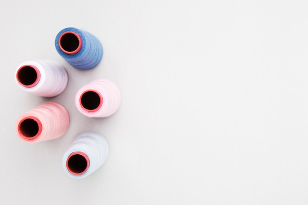 Reels of yarn on white background Free Photo