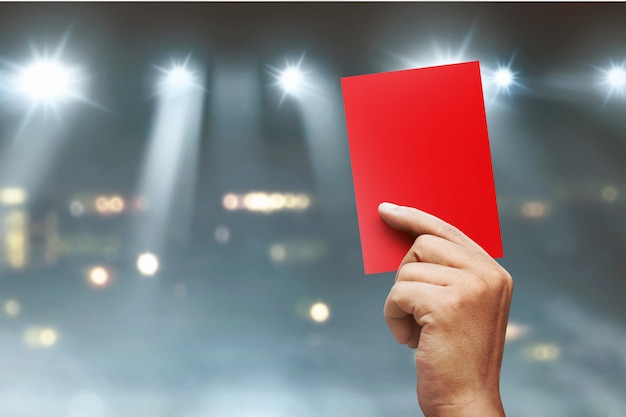 Referee hands showing red card Premium Photo