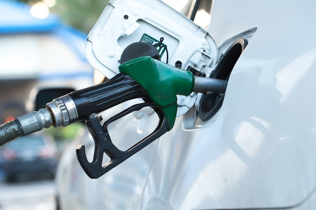 Refill and filling oil gas fuel at station Premium Photo