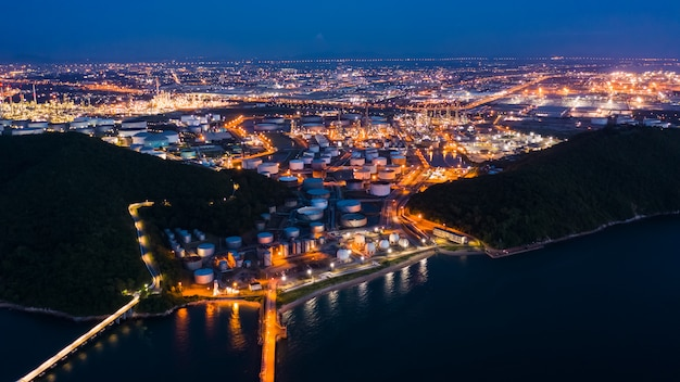 Refinery oil and petroleum zone at night in thailand Premium Photo