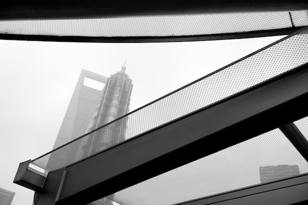 Reflection of jin mao tower on a window glass, lujiazui, pudong, shanghai, china Premium Photo