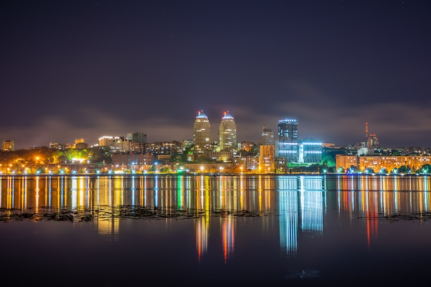 Reflection of the night city in a wide calm river. Premium Photo