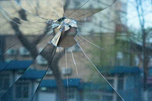 Reflection of street in broken glass on window Premium Photo