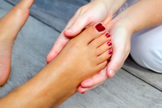 Reflexology woman feet massage therapy Premium Photo
