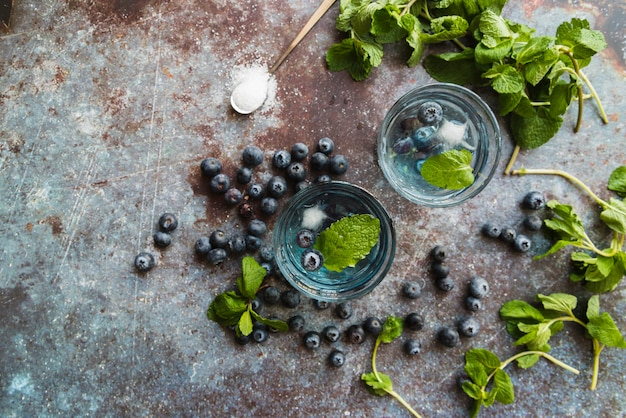 Refreshing cold drinks with blueberries and mint Free Photo
