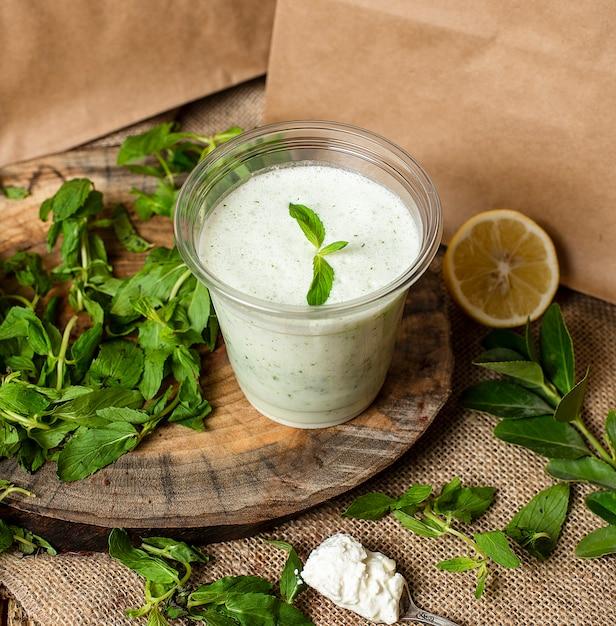 Refreshing cold yogurt shake with herbs and mint, ayran Free Photo