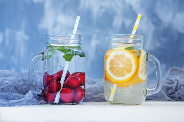 Refreshing fruit water in a glass jar. Premium Photo