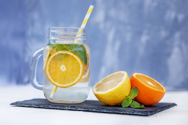 Refreshing lemonade with lemon, orange and mint. Premium Photo