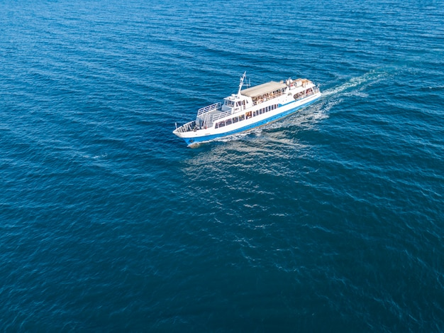 Refugees imigrants in the ferry boat ship aerial view in the sea concept Premium Photo