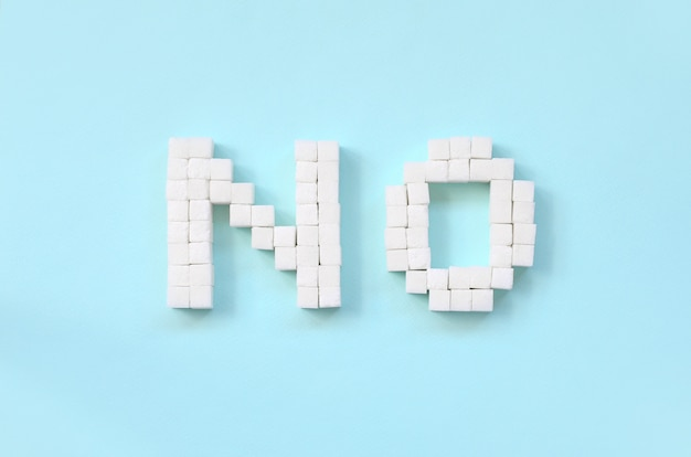 Refusing sugar sign with big letters on blue background Premium Photo