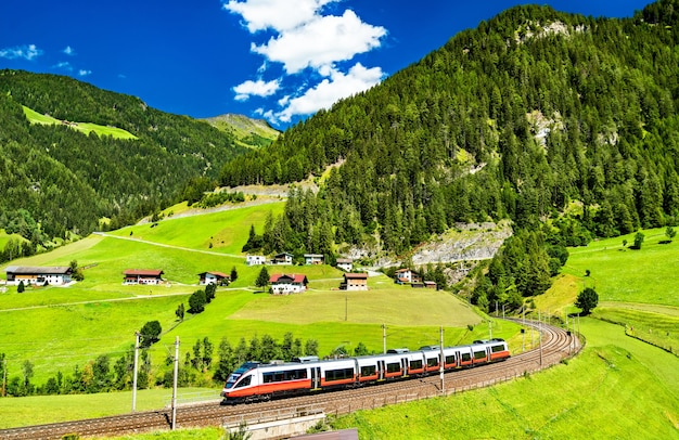 Regional train at the brenner railway in the austrian alps Premium Photo