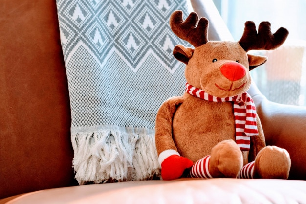 Reindeer plush toy. Christmas concept. Free Photo