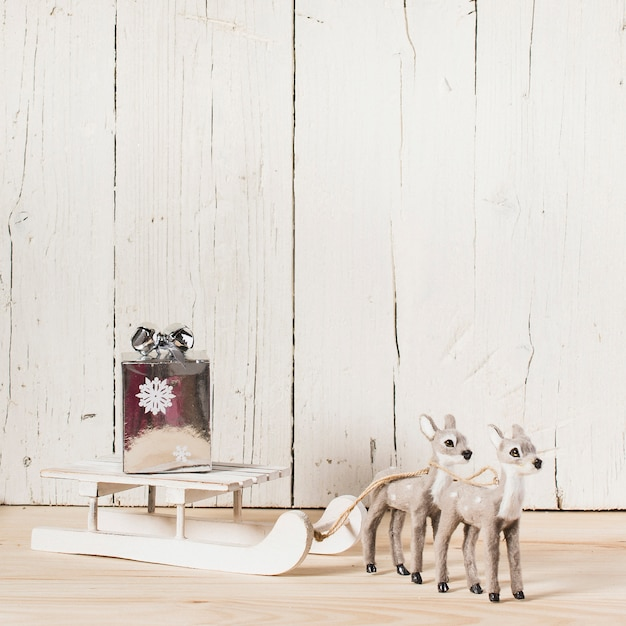Reindeer pulling the sleigh with copy space on top Free Photo
