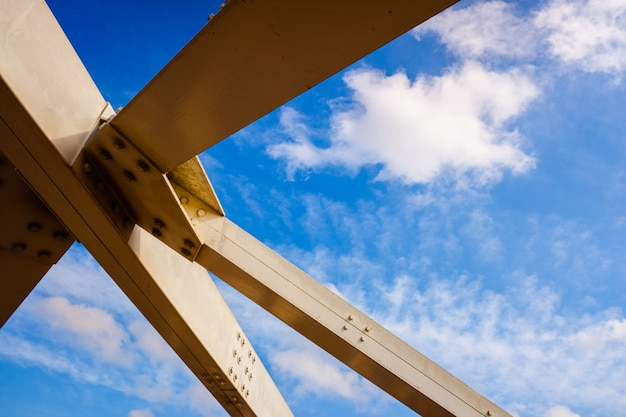 Reinforcement of the metal structure of a bridge, with white steel beams. Premium Photo