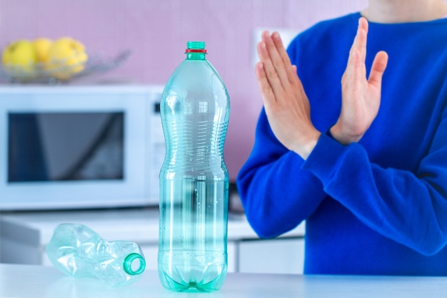 Rejection of plastic bottles and plastic recycling. environmental protection. stop plastic Premium Photo