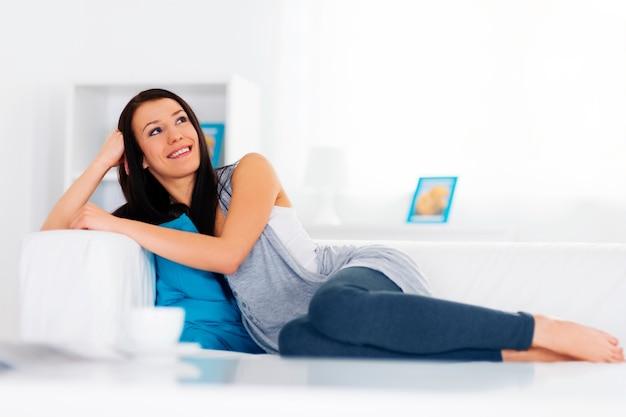 Relaxation on sofa Free Photo