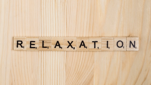 Relaxation word on wooden tiles Free Photo