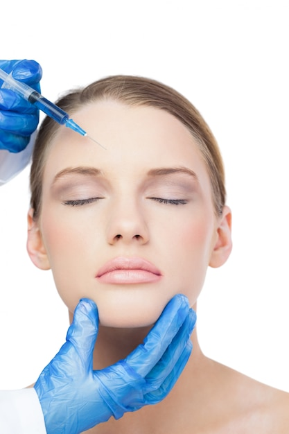 Relaxed attractive model having botox injection on the forehead Premium Photo