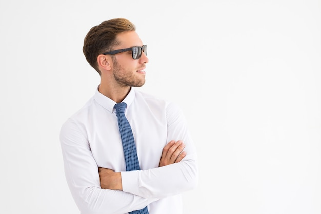 Relaxed business man wearing sunglasses and looking away Free Photo