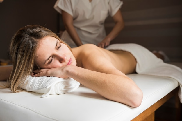 Relaxed woman getting massage in spa Free Photo