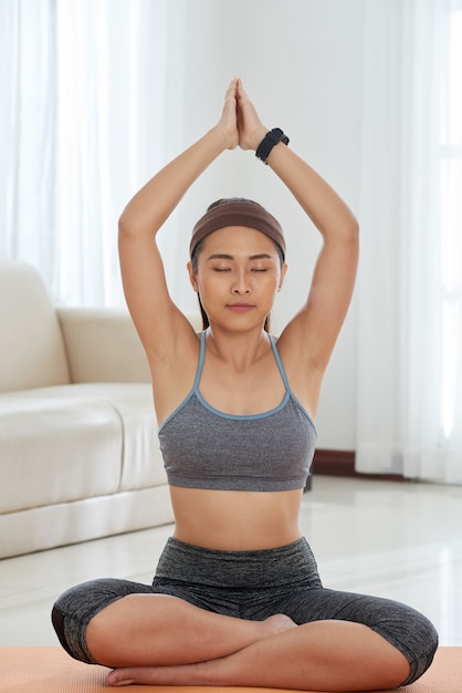Relaxed woman meditating at home Free Photo