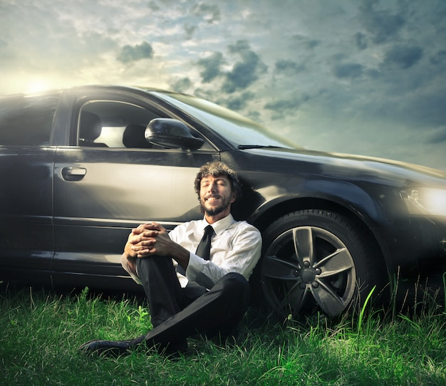 Relaxing next to a car Premium Photo