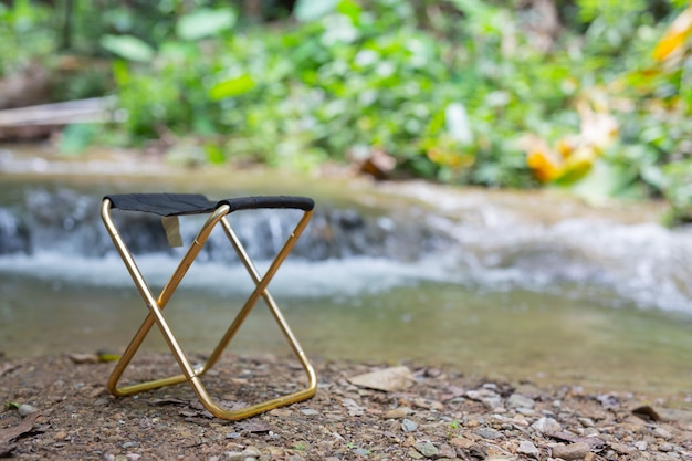Relaxing chairs are placed by the river. Free Photo
