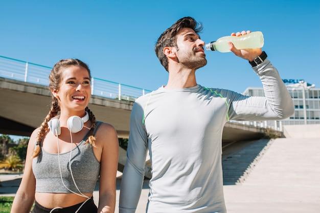 Relaxing couple walking on street Premium Photo